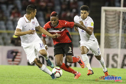 Photo: Trinidad and Tobago winger Joevin Jones (centre) terrorises United States players DeAndre Yedlin (right) and Michael Orozco during Russia 2018 World Cup qualifying action yesterday evening at the Hasely Crawford Stadium in Port of Spain. (Courtesy Allan V Crane/Wired868)