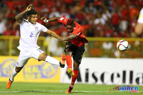 Photo: Trinidad and Tobago winger Joevin Jones (right) gets a shot off under pressure from United States midfielder DeAndre Yedlin. Trinidad and Tobago and USA played to a goalless draw at the Hasely Crawford Stadium tonight in 2018 World Cup qualifying action. (Courtesy Allan V Crane/Wired868)