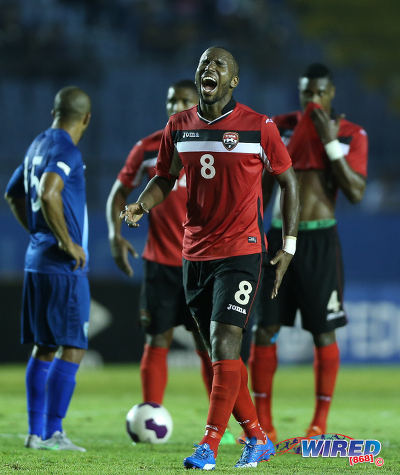 "Photo: Feeling it! Trinidad and Tobago midfielder Khaleem Hyland (centre) roars during Russia 2018 World Cup qualifying action last night in Guatemala City. Hyland scored in a 2-1 win for the ""Soca Warriors."" (Courtesy Allan V Crane/Wired868)"