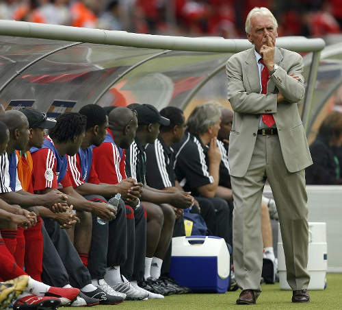 Photo: Trinidad and Tobago Leo Beenhakker (standing) considers his options during 2006 World Cup action against England. (Copyright AFP 2015)