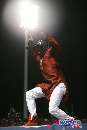 Photo: Trinidad and Tobago soca entertainer Swappi tries to rouse the ground during halftime between Trinidad and Tobago and the United States at the Hasely Crawford Stadium, Port of Spain.  (Courtesy Allan V Crane/Wired868)