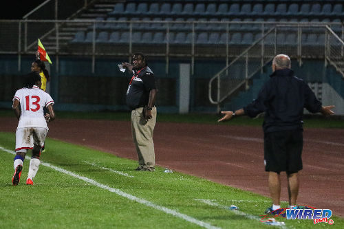Photo: Trinidad and Tobago interim head coach Anthony Creece (centre) directs right back Annalis Cummings (left) during 2016 Olympic qualifying action at the Ato Boldon Stadium in Couva. (Courtesy Chevaughn Christopher/Wired868)