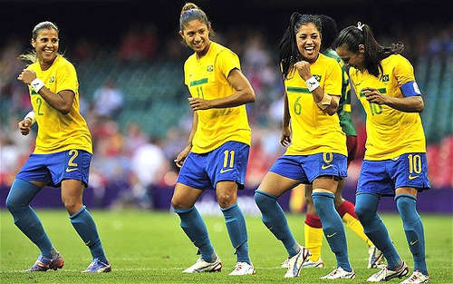 Photo: The Brazil Women's National Senior Team celebrate during the London 2012 Olympics. (Copyright UK Telegraph)