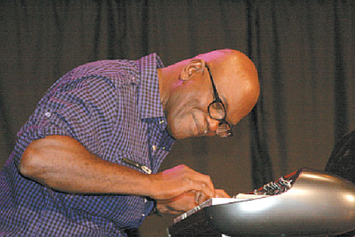 "Photo: The late Rafael ""Raf"" Robertson on the piano. (Copyright Trinidad Guardian)"