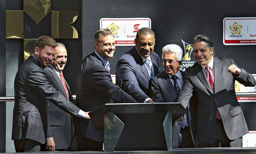 Photo: All in gentlemen! Traffic television company president Aaron Davidson (second from right) and former CONCACAF president Jeffrey Webb (third from right) spend a rare moment in the open. (Copyright UK Guardian)