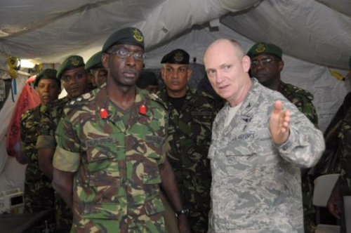 Photo: Defence Force Brigadier Anthony Spencer (left).