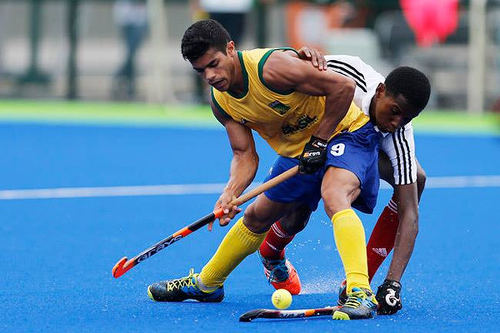 Photo: Trinidad and Tobago's Teague Marcano (right) tries to steal the ball during international hockey action against Australia.