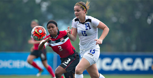 Photo: Trinidad and Tobago Women's National Under-20 captain Renee Mike (left) chases Honduras attacker Jinan Abdalah during 2015 CONCACAF Under-20 Championship action in San Pedro Sula, Honduras. (Copyright MexSport/CONCACAF)