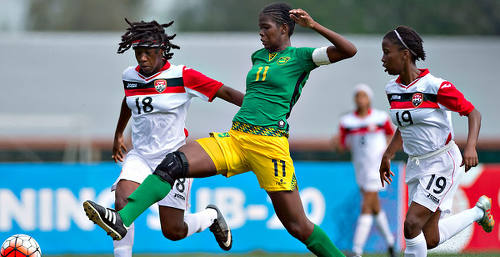 Photo: Jamaica Women's National Under-20 player Khadija Shaw (centre) stretches for the ball between the Trinidad and Tobago pair of Naomie Guerra (left) and Ranae Ward during CONCACAF Under-20 Championship action in San Pedro Sula, Honduras. (Copyright MexSport/CONCACAF)
