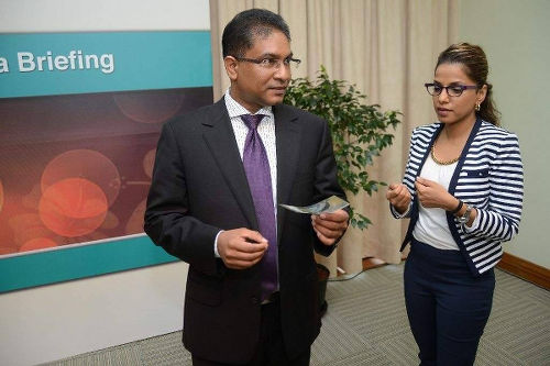 Photo: Former Central Bank governor Jwala Rambaran (left) and communications manager Charlene Ramdhanie.