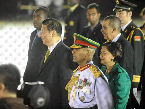 Photo: Major General Kenrick Maharaj (foreground) stands alongside then prime minister Kamla Persad-Bissessar (second from right), China president Xi Jinxing (left) and Trinidad and Tobago president Anthony Carmona (right). (Courtesy News.Gov.tt)