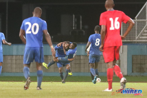 Photo: Police FC winger Christon Thomas (centre) is congratulated by teammate Kevin Lewis after his goal against Club Sando during 2015/16 Pro League action in Couva. (Courtesy Chevaughn Christopher/Wired868)