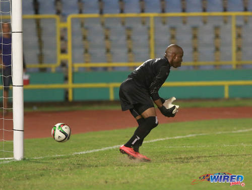 Photo: Prisons FC goalkeeper Jevon Bourne fails to hold on to QPCC playmaker Jason Devenish's free kick during last night's decisive CNG National Super League (NSL) Championship Division affair at the Hasely Crawford Stadium. (Courtesy Nicholas Bhajan/Wired868)