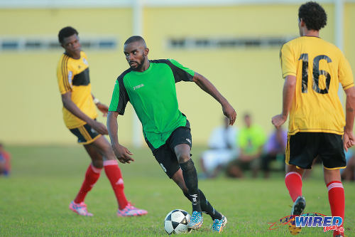 Photo: Prisons FC winger Ricardo Alleyne (centre) in 2015 CNG National Super League (NSL) Championship Division action against Cunupia FC at YTC, Arouca. (Courtesy Allan V Crane/Wired868)