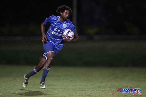 Photo: QPCC attacker Jerome Charles sprints back to the centre circle after his second half goal against UTT during 2015 CNG NSL Championship Division action last night at UTT Grounds, Arima.  (Courtesy Allan V Crane/CA-images/Wired868)