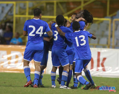 Photo: QPCC players mob scorer Shabaka Mahluli to celebrate their team's opening goal during last night's decisive CNG National Super League (NSL) Championship Division affair against Prisons FC at the Hasely Crawford Stadium. (Courtesy Nicholas Bhajan/Wired868)