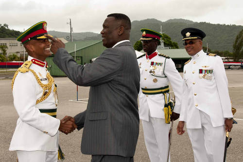 Photo: Former National Security Minister John Sandy (second from left) greets Chief of Defence Staff Major-General Kenrick Maharaj (left) while Brigadier Anthony Spencer (second from right) looks on. (Courtesy News.Gov.tt)