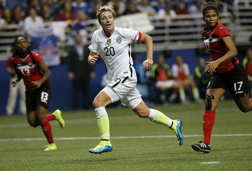 Photo: United States record goal scorer Abby Wambach (centre) tries to sniff out an opportunity while Trinidad and Tobago defender Victoria Swift (right) keeps watch during international friendly action in San Antonio on Friday December 11. (Copyright AFP 2015/Chris Covatta)