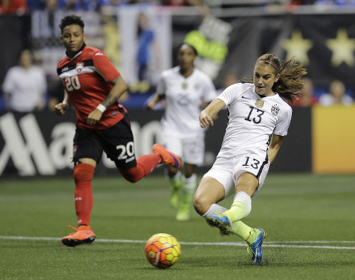 Photo: United States striker Alex Morgan (right) goes for goal while Trinidad and Tobago defender Lauryn Hutchinson looks on during international friendly action in San Antonio on Thursday December 10. (Courtesy TTFA Media)