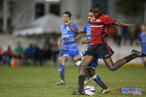 Photo: UTT star striker Jamal Creighton (right) drives towards goal during 2015 CNG NSL Championship Division action last night at UTT Grounds, Arima.  (Courtesy Allan V Crane/CA-images/Wired868)