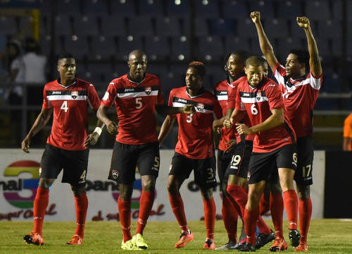 Photo: Trinidad and Tobago National Senior Team players celebrate during their Russia 2018 World Cup qualifying win over Guatemala on 13 November 2015. From left are Sheldon Bateau, Daneil Cyrus, Joevin Jones, Kevan George, Radanfah Abu Bakr and Mekeil Williams. (Copyright AFP 2015/Johan Ordonez)