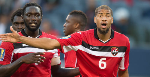 Photo: Trinidad and Tobago captain Kenwyne Jones (left) and defender Radanfah Abu Bakr wait for a set piece during international action in 2015. (Copyright AFP 2016)