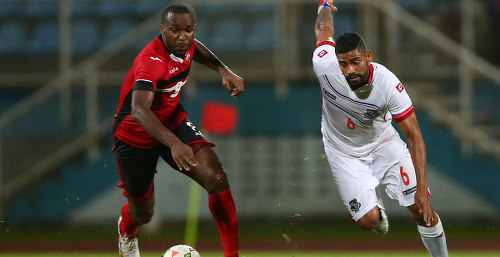 Photo: Trinidad and Tobago midfielder Khaleem Hyland (left) chases Panama midfielder Gabriel Gomez during international friendly action in Couva. (Copyright CONCACAF)