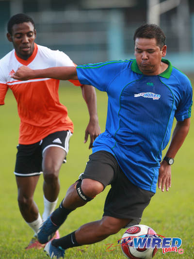 Photo: Wired868 player and 1991 World Youth playmaker Anthony Sherwood (right) in action during the 2015 Wired868 Football Festival at the UWI SPEC grounds in St Augustine. (Courtesy Allan V Crane/Wired868)