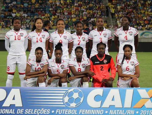 Photo: The Trinidad and Tobago Women's National Senior Team pose before kick off against Brazil on December 9. The weakened Trinidad and Tobago team lost 11-0. (Courtesy TTFA Media)