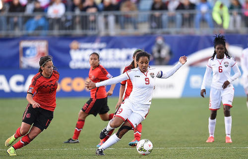 Photo: Trinidad and Tobago playmaker Maylee Attin-Johnson (centre) in action against Mexico during the 2014 CONCACAF Championship. (Copyright CONCACAF)