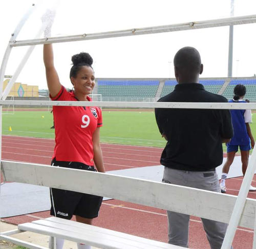 Photo: Trinidad and Tobago Women's National Senior Team playmaker Maylee Attin-Johnson (left) has a word with TBL boss and football agent, Narada Wilson.