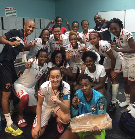 Photo: The Trinidad and Tobago Women's National Senior Team celebrate after topping the Caribbean phase of the Rio 2016 Olympic qualifying competition. (Courtesy TTFA Media)