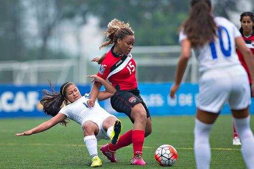 Photo: Trinidad and Tobago defender Paul Shenieka (centre) hustles Honduras playmaker Fatima Romero off the ball in 2015 CONCACAF Women's Under-20 Championship action. (Copyright MexSport/CONCACAF)