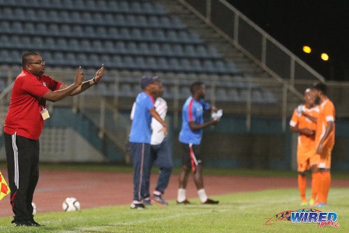 Photo: Morvant Caledonia United coach Rajesh Latchoo (far left) gives instructions during 2015/16 Pro League clash with Club Sando at the Ato Boldon Stadium, Couva. Latchoo was promoted from assistant to head coach for the 2016/17 season. (Courtesy Chevaughn Christopher/Wired868)