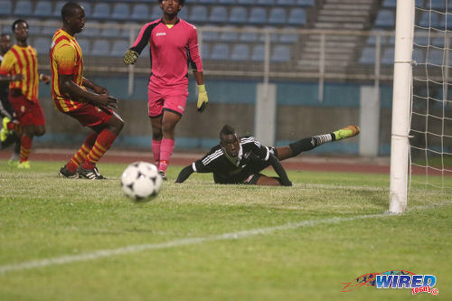 Photo: Central FC attacker Kadeem Corbin (right) watches an effort go wide while Point Fortin Civic custodian Miles Goodman (centre) breathes a sigh of relief during their 2015/16 TT Pro League clash last night in Couva. (Courtesy Chevaughn Christopher/Wired868)