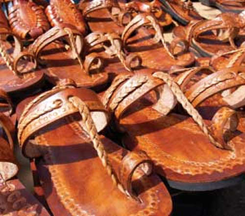 Photo: The Drag Brothers showcase their leather sandals. (Copyright Discover TNT)