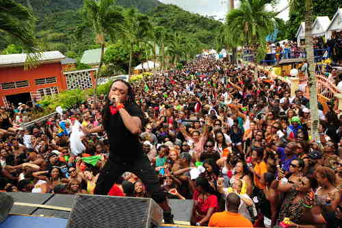 Photo: Soca star Machel Montano moves the crowd at a fete during a previous Carnival season. (Copyright The Playmakers)
