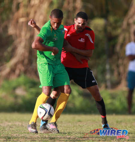 "Photo: Guaya United star striker Carlon ""Judgment"" Hughes (left) holds off Matura ReUnited defender Deon Capriata during 2015/16 CNG NSL Premiership Division action in Matura. (Courtesy Nicholas Bhajan/WIred868)"