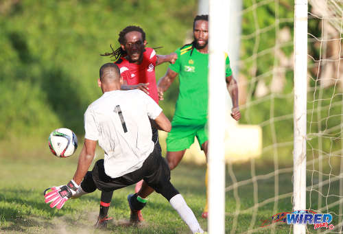 Photo: Guaya United goalkeeper Erskine Johnson (left) makes a crucial save from Matura ReUnited captain Shervin Charles (centre) during 2015/16 CNG NSL Premiership Division action in Matura. Looking on is Guaya United flanker Leroy Jones. (Courtesy Nicholas Bhajan/WIred868)