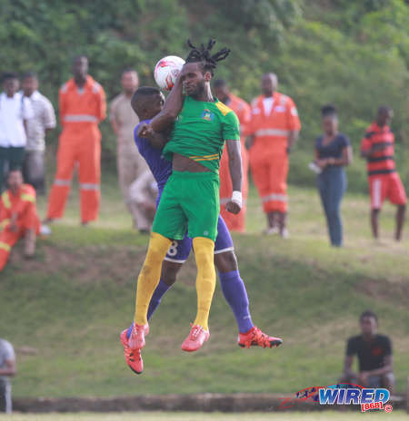 Photo: Guaya United winger Leroy Jones (right) challenges an aerial ball with Defence Force captain Chris Durity during 2015/16 CNG National Super League action in Guayaguare. (Courtesy Nicholas Bhajan/Wired868)