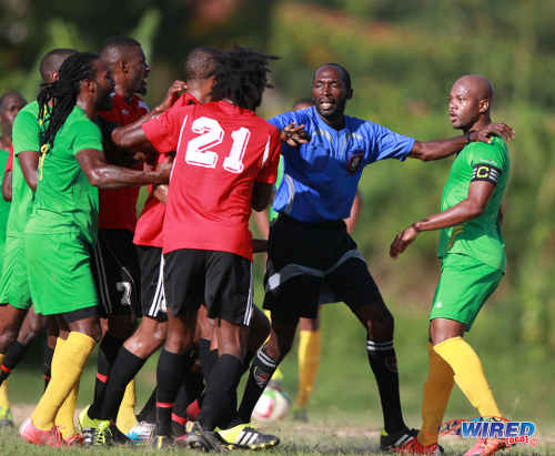 Photo: Referee Hasely Collette (centre) plays peacemaker while Guaya United captain Ryan Stewart (right) assesses the situation during 2015/16 CNG NSL Premiership Division action at Matura. (Courtesy Nicholas Bhajan/Wired868)