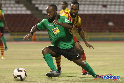 Photo: San Juan Jabloteh flanker Kennedy Hinkson (left) tries to elude Point Fortin Civic midfielder Kelvin Modeste during 2015/16 Pro League action at the Hasely Crawford Stadium. (Courtesy Chevaughn Christopher/Wired868)