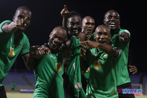 Photo: San Juan Jabloteh players (from right) Rickardo Harriott, Damian Williams, Brent Sam, Keyon Edwards, Kennedy Hinkson and Jamal Gay celebrate Edwards' second half winner during 2015/16 Pro League action yesterday at the Hasely Crawford Stadium. (Courtesy Chevaughn Christopher/Wired868)