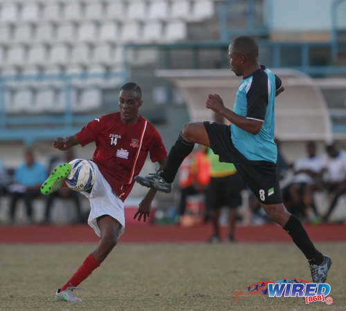 Photo: La Horquetta SA's Cedric Commissiong (left) takes on WASA FC's Kevon Henry during 2015/16 CNG National Super League Premiership Division action yesterday at the Larry Gomes Stadium, Malabar. (Courtesy Nicholas Bhajan/Wired868)