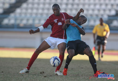 Photo: La Horquetta SA right back Ricardo Cornwall (right) clashes with WASA FC left back Dillon Peterson during 2015/16 CNG National Super League Premiership Division action yesterday at the Larry Gomes Stadium, Malabar. (Courtesy Nicholas Bhajan/Wired868)