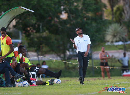 Photo: Real Maracas coach Michael McComie (right) gestures on the sidelines during 2015/16 CNG NSL Premiership action against Stokely Vale at the Maracas Recreation Ground. (Courtesy Nicholas Bhajan/Wired868)