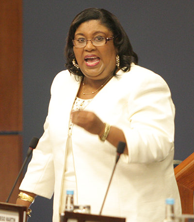 Photo: Housing Minister Marlene McDonald: Don't hate the playa. Hate the game. (Copyright Andy Hypolite/Trinidad Guardian)