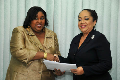 Photo: Housing Minister Marlene McDonald (left) with Culture Ministry Permanent Secretary Hermia Tyson-Cuffie. McDonald was Ministry of Community Development, Culture and Gender Affairs at the time of this photograph. (Copyright news.gov.tt)