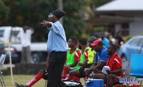 Photo: Matura ReUnited coach Devon Bobb points the way during 2015/16 CNG National Super League Premiership Division action against Petrotrin Palo Seco at the Matura Recreation Ground. (Courtesy Nicholas Bhajan/Wired868)