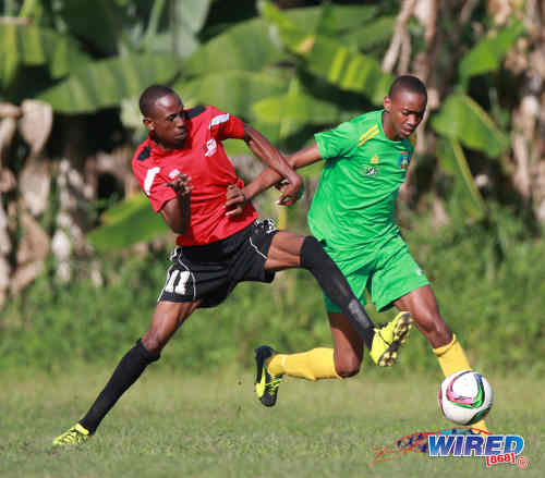 Photo: Matura ReUnited midfielder Joel Hoyte (left) tries to win the ball from Guaya United midfielder Reon Moore during 2015/16 CNG NSL Premiership Division action in Matura. (Courtesy Nicholas Bhajan/WIred868)